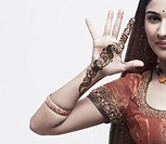Portrait of a young woman with henna tattoo´´s on her hand