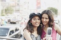 Close-up of two young women looking at a mobile phone