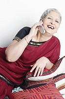 Mature woman using a mobile phone (thumbnail)