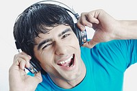 Portrait of a young man listening to music wearing headphones