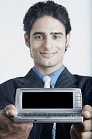 Portrait of a young man holding a mobile phone (thumbnail)