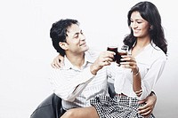 Young couple toasting with wine glasses