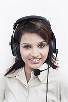 Portrait of a businesswoman wearing a headset smiling