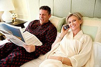 Mature couple relaxing in bed (thumbnail)