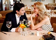 Couple having a romantic moment in a restaurant (thumbnail)