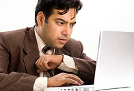 Close-up of a businessman using a laptop