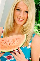 Woman holding a water-melon