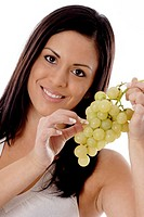 Woman holding green grapes (thumbnail)