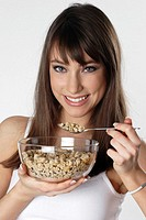 Woman having breakfast cereal (thumbnail)