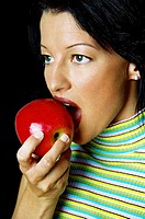 Woman biting on an apple