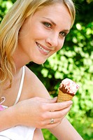 Woman holding an ice-cream cone