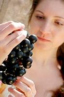 Woman looking at grapes.