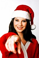 Woman in santa suit pointing at the camera
