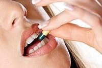 Woman taking medicine.