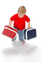 Boy carrying bags