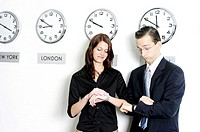 Corporate people checking the time