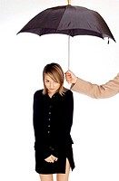 Man's hand shading woman with an umbrella
