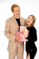 Woman looking happy to receive presents from her boyfriend