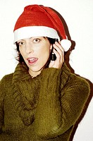 Woman with christmas hat talking on the mobile phone
