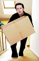 Man carrying a box up the stairs