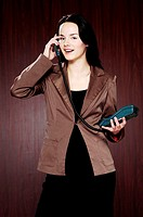 Businesswoman answering call