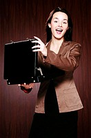 Businesswoman opening a briefcase