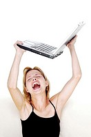 Angry woman about to throw her laptop
