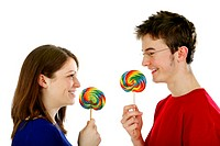 Man and woman holding candy
