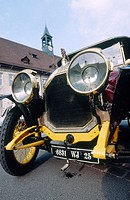 Touring with an old Peugeot 1913 and his owner. Mr. Lesueur. Montbeliard. Doubs. Franche-Comté. France.