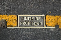 Sign on pavement. Mexico City, Mexico