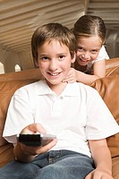Sister and brother with remote control