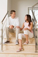 Couple having conversation on the stairs