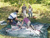 Family putting up tent