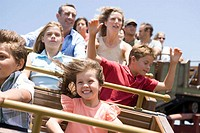 Family riding a rollercoaster