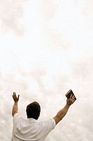 Man worshipping with bible