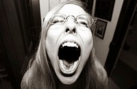 Girl screaming with mouth wide open