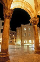 Nightime view from the Rector's Palace pillars and archway framing picture, old town Dubrovnik. Croatia