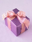 Christmas gift wrapped in a pink ribbon