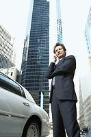 Executive next to his limousine