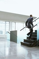 Businessman rushing up the stairs