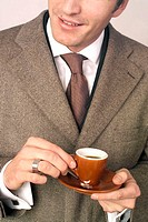 Business man holding a cup of espresso