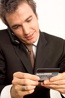Business man calling with credit cards