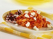 Greek rice noodles with tomatoes and feta