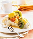 Piece of Pavlova (meringue cake with cream and exotic fruit)
