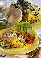 Vegetable polenta with grated cheese and salad