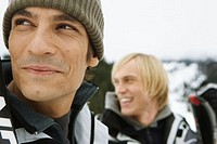 Two men in snow field, smiling, close-up