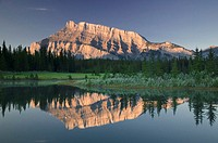 Canada, Alberta, Mt. Rundle reflected in Cascade Pond at sunrise