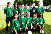 Portrait of girls (12-15) football team, smiling