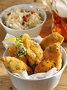 Breaded chicken breast pieces with cabbage salad