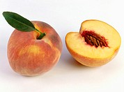 One half and one whole peach